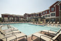 Upscale pool area view of large apartment complex Royalty Free Stock Photography