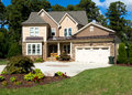 Upscale suburban house with landscaped front yard Royalty Free Stock Photo