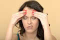 Upset angry unhappy stressed young woman with a painful headache dslr royalty free image an eyes closed and hands on forehead Stock Image