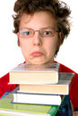 Upset boy with set of books Stock Image