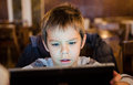 Upset Boy watching cartoons on tablet Royalty Free Stock Photo