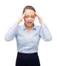 Upset businesswoman having headache business and office concept Royalty Free Stock Photography