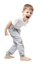 Upset child screaming standing isolated on white background Stock Photography