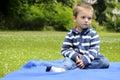 Upset child waiting in park Stock Photo