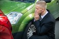 Upset driver looking at car after traffic collision Royalty Free Stock Photo