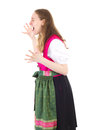 Upset girl shouting very loud in dirndl Stock Images