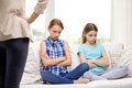 Upset guilty little girls sitting on sofa at home people children misbehavior friends and friendship concept feeling or displeased Royalty Free Stock Images
