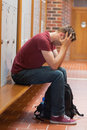 Upset handsome student holding his head Royalty Free Stock Photo
