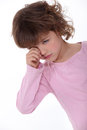 Upset little girl crying becuse she misses her parents Stock Photo