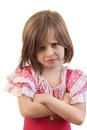 Upset little girl young with arms crossed in disappointment Stock Image