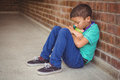 Upset lonely child sitting by himself Royalty Free Stock Photo