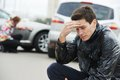 Upset man after car crash adult driver in front of automobile collision accident in city Stock Images
