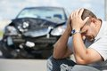 Upset man after car crash adult driver in front of automobile collision accident in city road Royalty Free Stock Photos