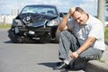 Upset man after car crash adult driver in front of automobile collision accident in city road Stock Images