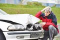 Upset man after car crash adult driver inspecting automobile body collision accident Royalty Free Stock Photo