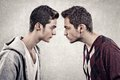 Upset men two young angry people standing face to face Royalty Free Stock Photography