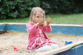 Upset preschooler blonde girl showing her dirty palms