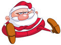 Upset santa claus sitting on the floor with crossed arms Royalty Free Stock Images