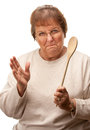 Upset Senior Woman with The Wooden Spoon Stock Photography