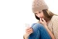 Upset teenage girl looking at her smartphone Royalty Free Stock Photo