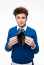 Upset young man holding emty wallet Royalty Free Stock Photo