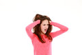 Upset young teen girl shocked with hands in hair looking away from camera isolated on white Royalty Free Stock Image
