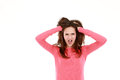 Upset young teen girl shocked with hands in hair looking at camera isolated on white Royalty Free Stock Images
