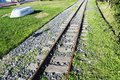 An upside down boat and railroad tracks on the grass in Istanbul, Turkey Royalty Free Stock Photo