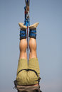Upside down a close up of a man hanging after bungee jumping Royalty Free Stock Photography