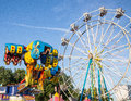 Upside down fair goers are tossed on this midway carnival ride Stock Images