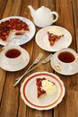 Upside down plum pie with ice-cream and black tea Royalty Free Stock Photo