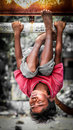 Upside down portrait of a young boy from lombok hanging indonesia Stock Photo