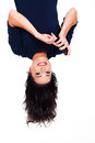Upside down view young happy woman reading emails smart phone Royalty Free Stock Images