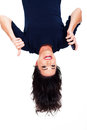 Upside down view young woman holding smart phone giving thumb up Stock Images