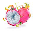 Upstanding full and half cut dragon fruit creatively composed on isolated white background Stock Image