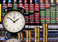 Uptrend stacks of golden coins clock and financial chart as background selective focus Royalty Free Stock Photography