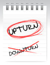 Upturn, crossed out the word downturn Stock Photography