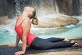 Upward facing dog urdhva mukha svanasana woman practicing yoga near waterfall Royalty Free Stock Photography