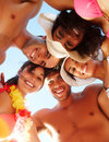 Upward view of group of friends at the beach Stock Images
