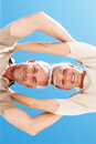 Upward view of a senior couple with heads together Stock Image