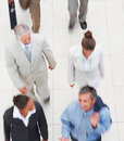 Upward view of a team of business people, walking Royalty Free Stock Photos