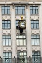 Urban antique clock on building Royalty Free Stock Photo