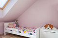 Urban apartment girls furniture wooden bed in child s room Royalty Free Stock Photography