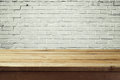 Urban background with empty wooden table and brick wall Royalty Free Stock Photo