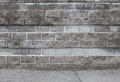 Urban background with old gray brick wall interior and asphalt Royalty Free Stock Photo
