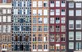 Urban background with residential building windows in Amsterdam Royalty Free Stock Photo