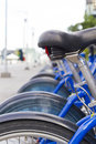 Urban bicycle parking different blue bicycles parked in a row Royalty Free Stock Images