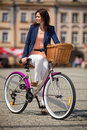 Urban biking middle age woman and bike in city leisure Stock Photo