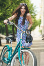 Urban biking young age woman and bike in city active people outdoors Royalty Free Stock Photos