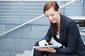 Urban business woman with tablet Royalty Free Stock Images